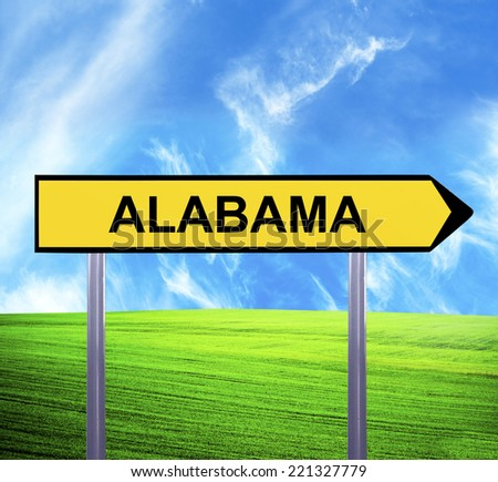 Conceptual arrow sign against beautiful landscape with text - ALABAMA - stock photo