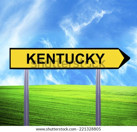 Conceptual arrow sign against beautiful landscape with text - KENTUCKY - stock photo