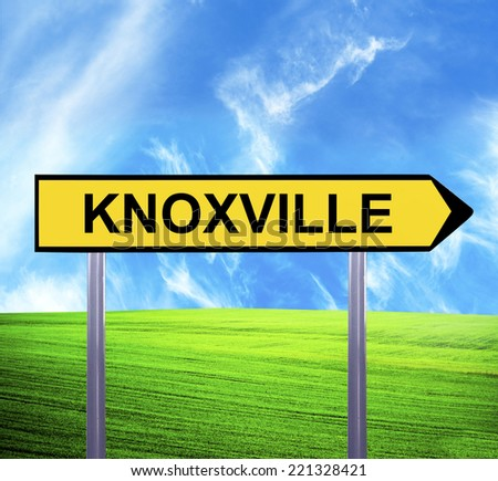 Conceptual arrow sign against beautiful landscape with text - KNOXVILLE - stock photo