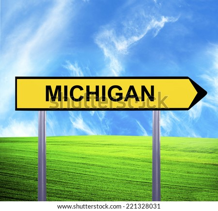 Conceptual arrow sign against beautiful landscape with text - MICHIGAN - stock photo