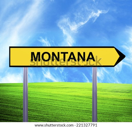 Conceptual arrow sign against beautiful landscape with text - MONTANA - stock photo