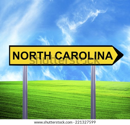 Conceptual arrow sign against beautiful landscape with text - NORTH CAROLINA - stock photo