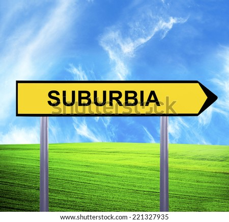 Conceptual arrow sign against beautiful landscape with text - SUBURBIA - stock photo