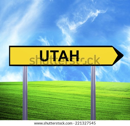 Conceptual arrow sign against beautiful landscape with text - UTAH - stock photo