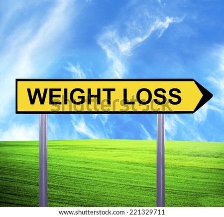 Conceptual arrow sign against beautiful landscape with text - WEIGHT LOSS - stock photo