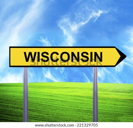 Conceptual arrow sign against beautiful landscape with text - WISCONSIN - stock photo