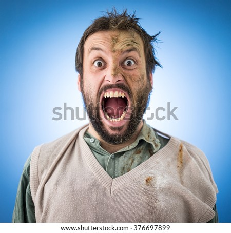 Conceptual artistic face portrait photo of a man with big screaming mouth - stock photo
