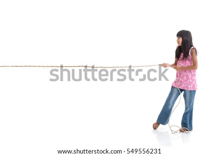 Conceptual Asian girl pulling on white background with copyspace