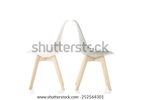 Conceptual Back to Back Elegant White Chairs with Wooden Legs Isolated on White Background - stock photo