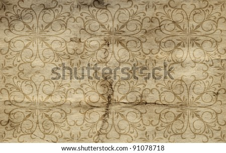 Conceptual brown or beige  old paper background, made of grungy or vintage texture stained or dirty surface ideal for holiday, antique or retro designs with a pattern, decoration or ornament printed