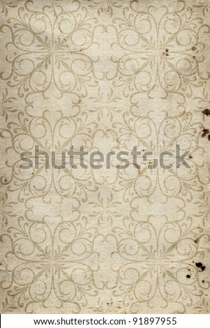 Conceptual brown or beige  old paper background, made of grungy or vintage texture stained or dirty surface ideal for holiday, antique or retro designs with a pattern, decoration or ornament printed - stock photo
