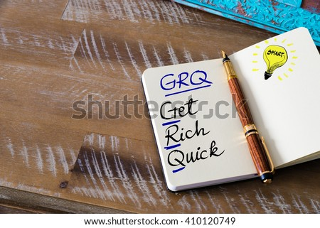 Conceptual Business Acronym GRQ Get Rich Quick. Retro effect and toned image of a fountain pen on a notebook - stock photo
