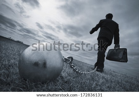 conceptual, businessman tethered and strained by stress, worry, anxiety - stock photo