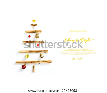 conceptual christmas card , shows an image of a christmas synthesis made with reed and toy christmas decorations  - stock photo