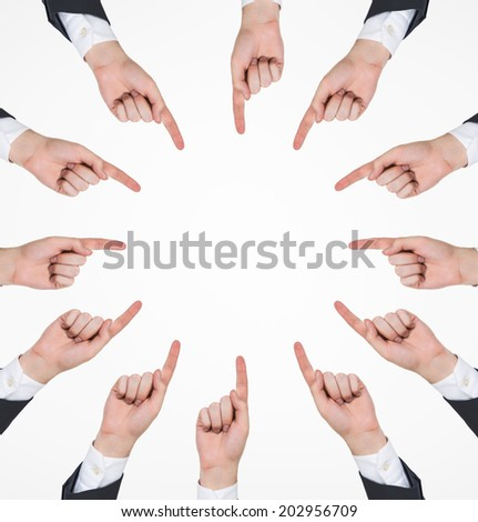 Conceptual circle symbol of men hands pointing out the white space in the middle - stock photo