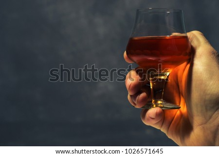 Conceptual composition, alcohol drink in a glass.