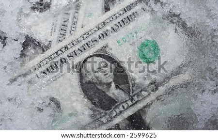 Conceptual composition: money under ice (frozen account) - stock photo