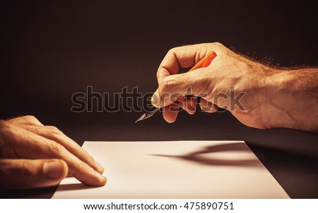 Conceptual composition of somebody writing a letter, view from the position of head.