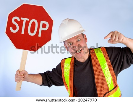 Conceptual Construction Worker Demanding to Stop for Something - stock photo