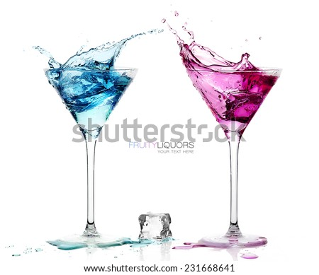 Conceptual Elegant Martini Glasses with Splashing Colored Cocktails with Ice Cube on the Table. Isolated on White Background with Copy Space at the Center. Template design with Sample Text - stock photo