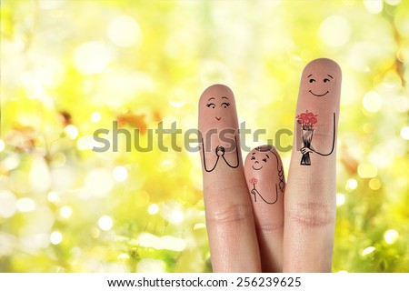 Conceptual family finger art. Father and daughter is giving flowers  his mother.  Happy  Mother's Day and 8 March creative and funny love series. Painted fingers concept There are path  in image.  - stock photo