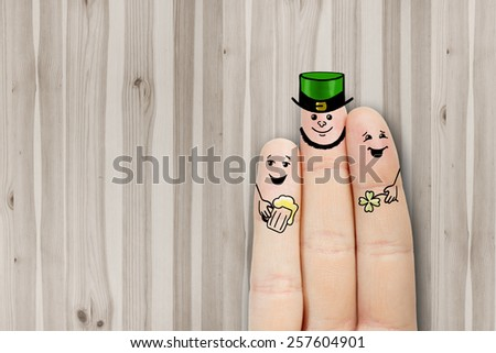 Conceptual finger art. friends are embracing and drinking beer. Stock Image. Saint Patrick's Day creative and funny male friendship series. Painted fingers concept  - stock photo