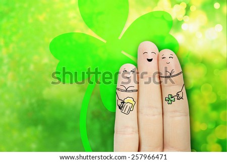 Conceptual Finger Art. Lovelace is embracing two girls and drinking beer. Saint Patrick's Day creative and funny lovers series. Painted fingers concept. - stock photo