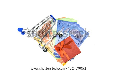 Conceptual for saving a bunch of ringgit malaysia banknotes filling a shopping cart, with cash, gift box - stock photo