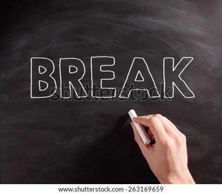 Conceptual Handwritten Break Text on Black Chalkboard, Captured in Close up. - stock photo