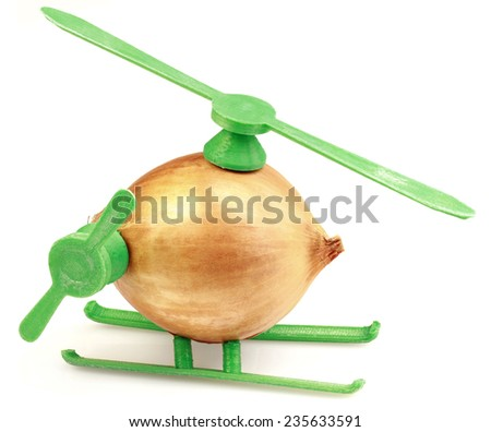 Conceptual Helicopter Toy Made with Onion and Plastic - stock photo