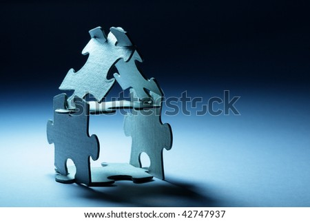 Conceptual home from puzzle - stock photo