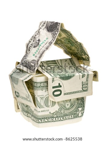 conceptual house made from crumpled dollar banknotes isolated on white