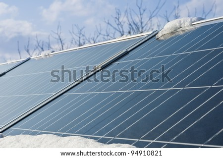 conceptual idea of energy limited during winter of photovoltaic panels - stock photo