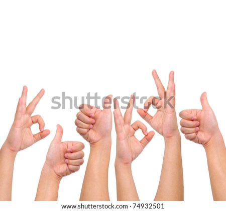 Conceptual image. A set of okay and thumb up hand signs isolated on white with copy space - stock photo