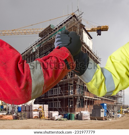 Conceptual image about agreements between contractors, and subcontractors in real estate building project - stock photo