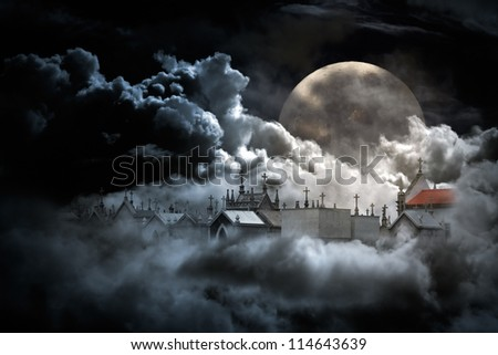 Conceptual image about death with cemetery in a cloudy sky in a full moon night - stock photo