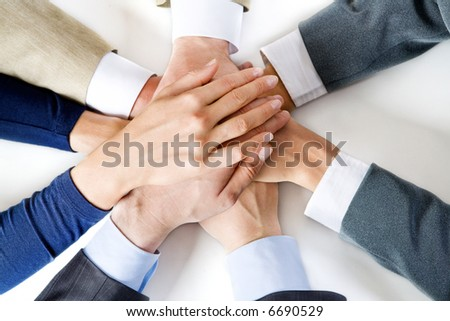 Conceptual image: different human hands on top of each other - stock photo