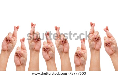 conceptual image, finger crossed hand sign isolated on white with a copy space - stock photo