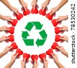 Conceptual image, giving heart to recycling. hand with heart isolated on white with recycle icon in the middle. - stock photo