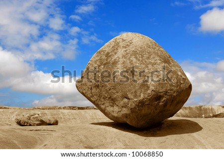 Conceptual image of a balancing rock in Mahabalipuram, India - stock photo