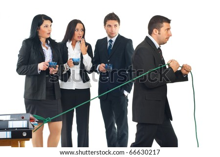 Conceptual image of a business man working hard and shocking his colleagues by doing this while they enjoy  drinking coffee in a break - stock photo