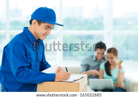 Conceptual image of a couple making an online order and a delivery guy providing the service - stock photo
