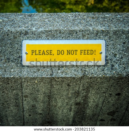 Conceptual Image Of A Do Not Feed Sign At A Zoo