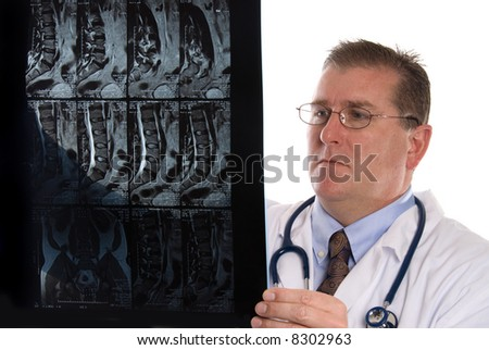 Conceptual image of a doctor examining a patients MRI.  Intended for any use where a medical inference is needed. - stock photo