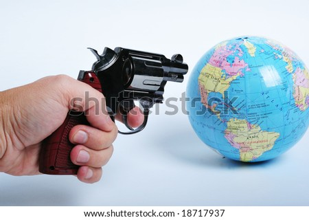 Conceptual image of a gun threatening the world suggesting terrorism - stock photo