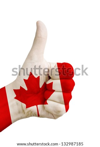 Conceptual image of a hand with thumb up covered with the Canadian flag to show support for Canada isolated on white background - stock photo
