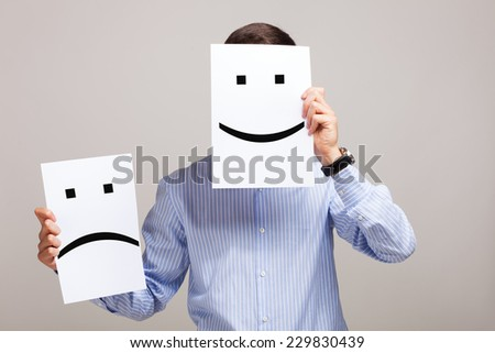 Conceptual image of a man changing his mood from bad to good - stock photo