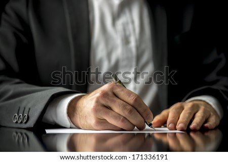 Conceptual image of a man signing a last will and testament document. - stock photo