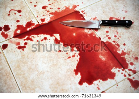 Conceptual image of a sharp knife with blood on it resting on tiles on the floor - stock photo
