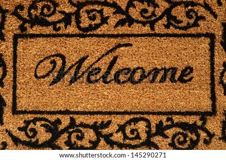 Conceptual Image Of A Welcome Door Mat - stock photo
